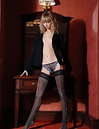 Skinny blonde with small breasts posing near dramatize expunge stockings